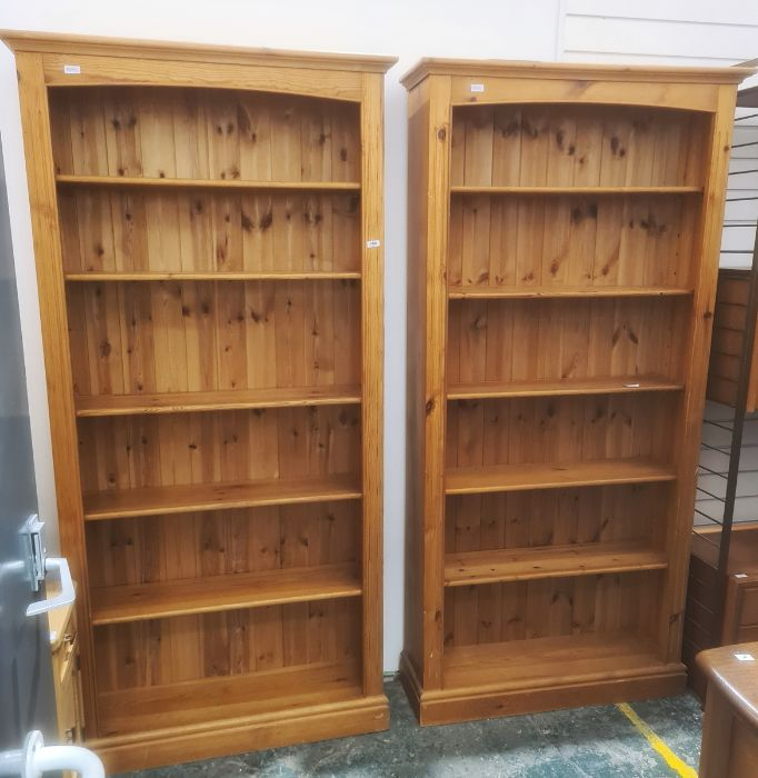 Pair of pine bookcases, plinth bases (2)Condition Report Approx. Dimensions: H198cm x W96cm x D29.
