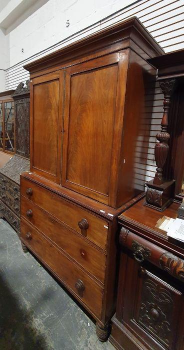 19th century mahogany linen press, two flame mahogany doors enclosing linen press drawers, base