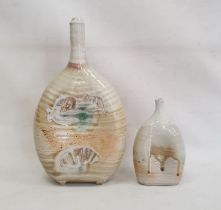 Two studio pottery vasesdecorated with sea shells on pale green ground (2)