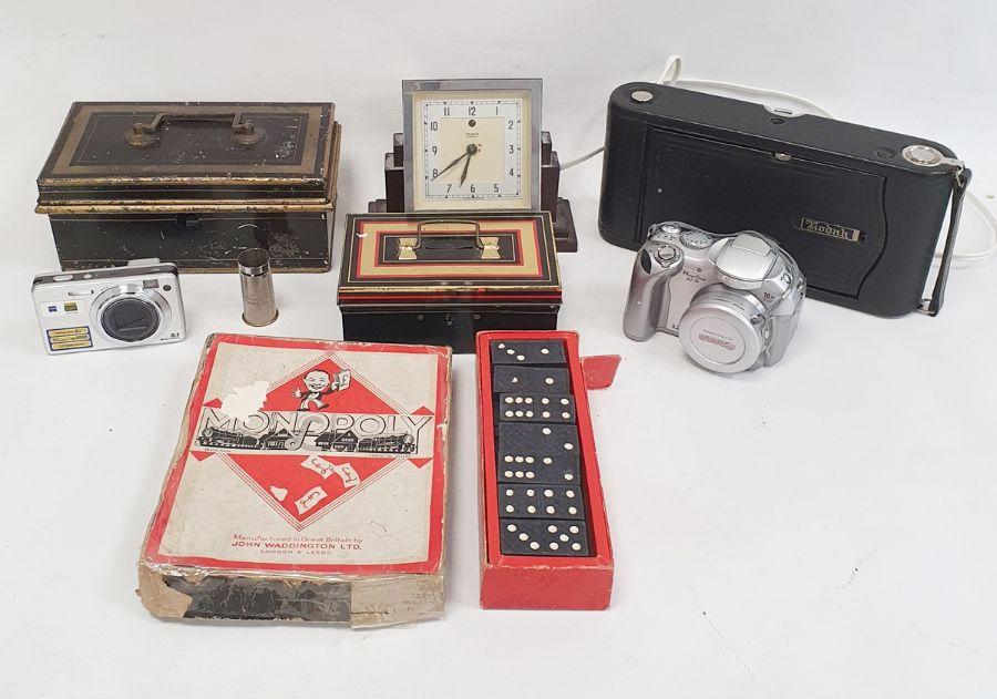 Kodak camera, vintage cash tins, a Tenko electric clockin bakelite case, games, etc