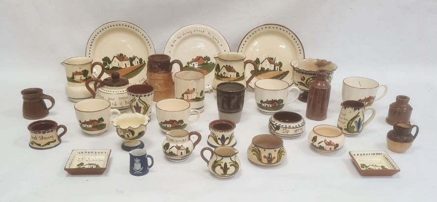 Large quantity of Devon pottery motto wareincluding cups, jugs, teapot, etc and a quantity of other