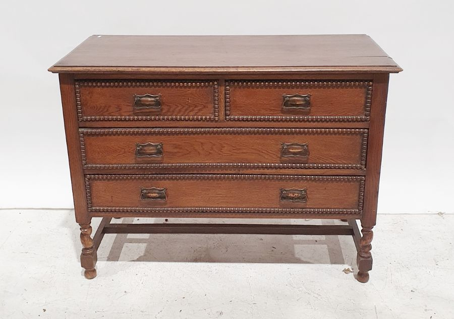 20th century oak chest of two short over two long drawers on barleytwist and block supports,