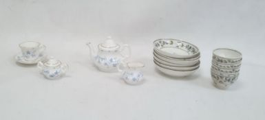 Set of 18th century child's tea bowls and saucersdecorated with bands of leaves and blue flowers,
