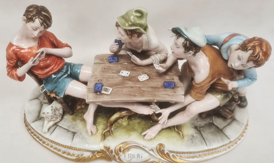 Ciche porcelain figural groupof boys seated at a table playing cards, the oval base with gilt - Image 2 of 6