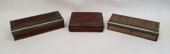 Three eastern style boxes all with parquetry inlay, one opening to reveal inlaid roundel to interior