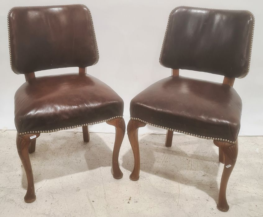 Pair of brown leather covered office chairsin the French taste, cabriole legs (2)