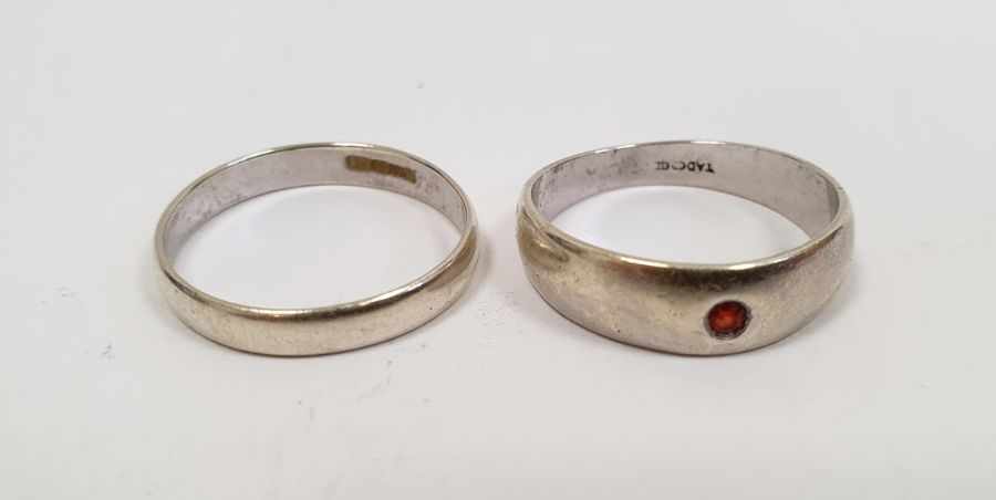 9ct white gold ring set with tiny red stone, 3g approx. and a 9ct white gold wedding band, 1.5g