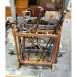Stickstand and contentsincluding a turned ebony stick, a stick with silver finial, shooting sticks,