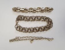 Silver bracelet of multiple interlocking links, another silver-coloured bracelet of oval and bar