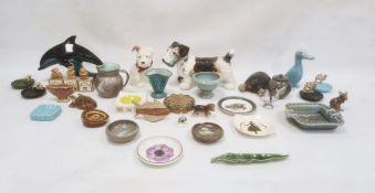 Crown Devon modelof a schnauzer dog, a Poole pottery modelof a dolphin, a Wade ashtrayand various