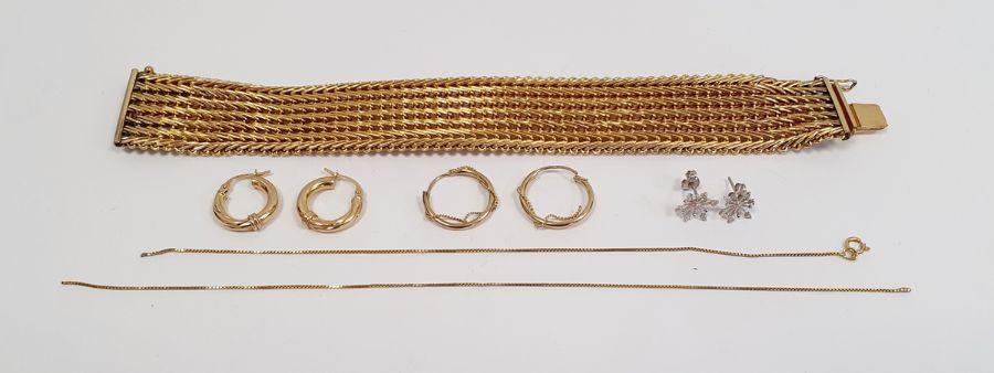 A Charles Murat gold coloured metal heavy chain link bracelet, a pair of 9ct gold hoop earrings,