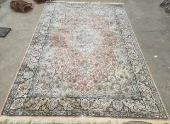 Modern Eastern-style rug, peach ground foliate decorated field with pale green central medallion and