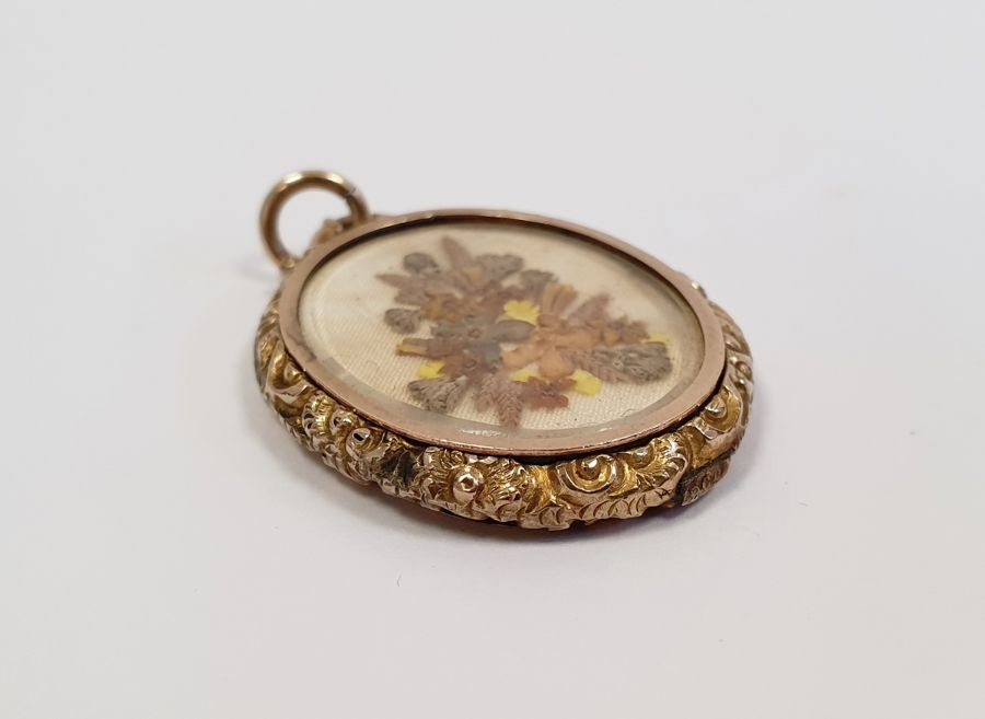 9ct gold double glass locket, oval with scroll surmount, chased sides inset with small pressed - Image 3 of 3