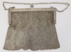 An early 20th century silver chain purse, with import marks, marked 925, foliate detail to clutch,