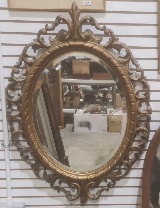 Oval mirror in modern moulded acanthus leaf frame