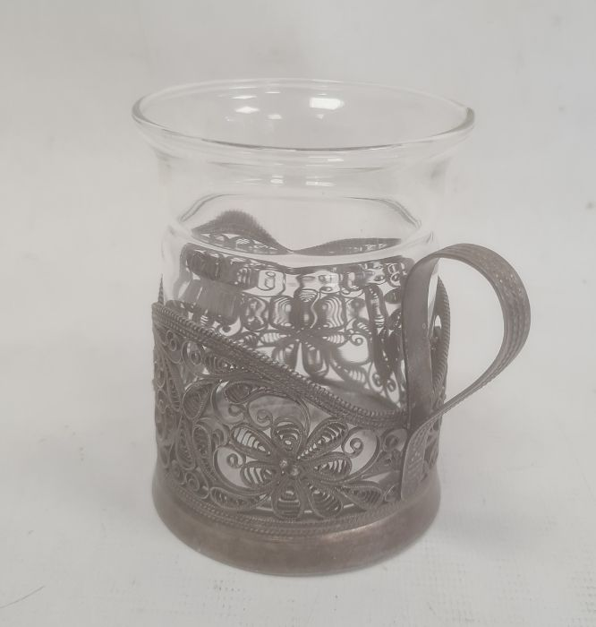 Silver-coloured metal filigree cup holder, flower decorated, with marks to base and a glass cup(not - Image 2 of 3