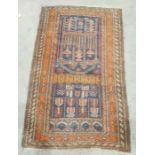 Eastern navy ground rugwith hooked medallions, on a stepped border, 138cm x 88cm