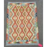 Chobi kilim rug with central field with lozenges within red borders, 148cm x 105cm