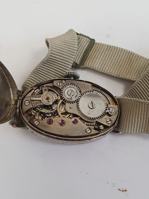 A 1920s platinum and diamond lady's wristwatch on fabric strap, oval with Arabic numerals and an - Image 6 of 10
