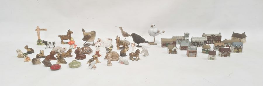 Quantity of Wade miniature model buildings including a church, a water mill, houses, etc and various