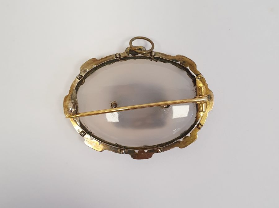 Victorian moonstone and gold-coloured metal mourning brooch, the oval stone bevelled and set with - Image 2 of 2