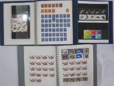Two boxes with decimal mint stamps, face value £350 approx. in three albums and plastic bags, a