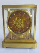 Atmos Jaeger-Le-Coultre clockin brass and glazed case, serial no. 75177, with customer's