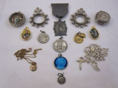 9ct gold St Christopher pendanton chain, 2g approx., various Virgin Mary pendants, a silver-