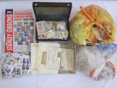 Box of loose stampsplus wooden box of stamps, astockbook and analbum of miscellaneous