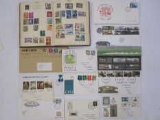 Post boy stamp albumwith loose GB first day covers, some with railway theme