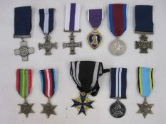 Eleven copies / reproduction metals to include Victoria Cross and Military Cross enclosed in