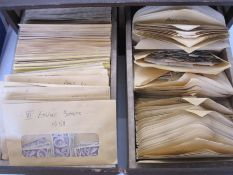 Many hundreds of envelopeswith loose stamps from a variety of countries, mainly GB, in two drawer