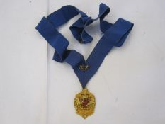 9ct gold medal with Gloucester City Coat of Arms, inscription on back 'PERCY DANIEL CLARKE, M.B.E