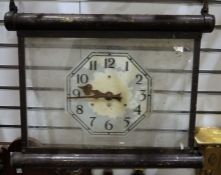 Hanging clockwith Arabic numerals to the glass dial