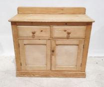 Early 20th century pine dresser, the rectangular top with rounded front corners, above two drawers