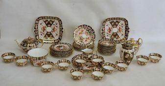 Royal Crown Derby Imari pattern teaset, no.2451, viz:- 12 cups and saucers, 12 tea plates plus 2