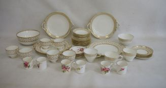 Set of six Royal Worcester coffee cans and saucers, floral spray decorated, a quantity of white