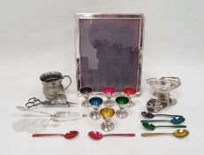Silver-coloured metal rectangular picture frame, a collection of metal eggcups with coloured