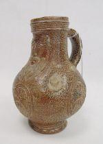 Rhenish stoneware bellarmine jugapplied three continental crests in oval tablets, 20cm high