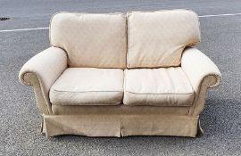 Modern two-seat sofain cream upholstery