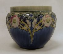 Royal Doulton stoneware jardiniere, floral and leaf tube-lined design, on a blue ground, marked to