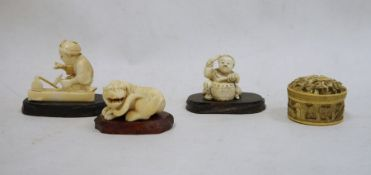 Japanese carved ivory okimonoof a seated worker with hammer, signed to base, 4.5cm high, a Japanese