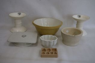 Two G Rushbrooke pottery ham stands, a stoneware mortar with glass pestle, a William Douglas &
