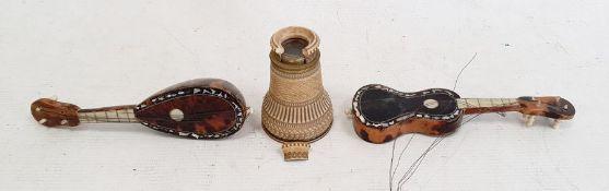 Miniature tortoiseshell guitarand a similar mandolin together with ivorine and brass mounted