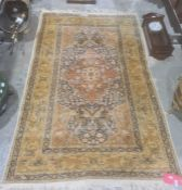 Eastern silk rug, blue ground field decorated with various animals and flowers, red ground central