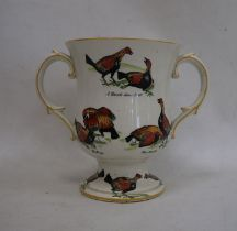 Ceramic two-handled trophy cupdecorated with fighting birds 'A Challenge', 'A Knock Down Blow',