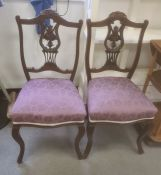 Pair of mahogany-framed bedroom chairswith purple upholstered overstuffed seats, cabriole front