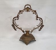 Silver-coloured metal and clear glass table epergne, the circular bowl to centre flanked by a pair