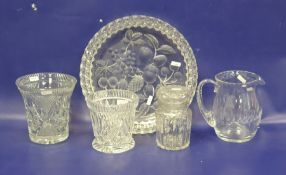 Cut glass water jug, two slice cut vases, a canisterand a large cut strawberry-pattern shallow dish
