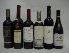 One bottle Vinalba Malbec 2012, one bottle Marques de Riscal Rioja 2000, one bottle Ravens Wood